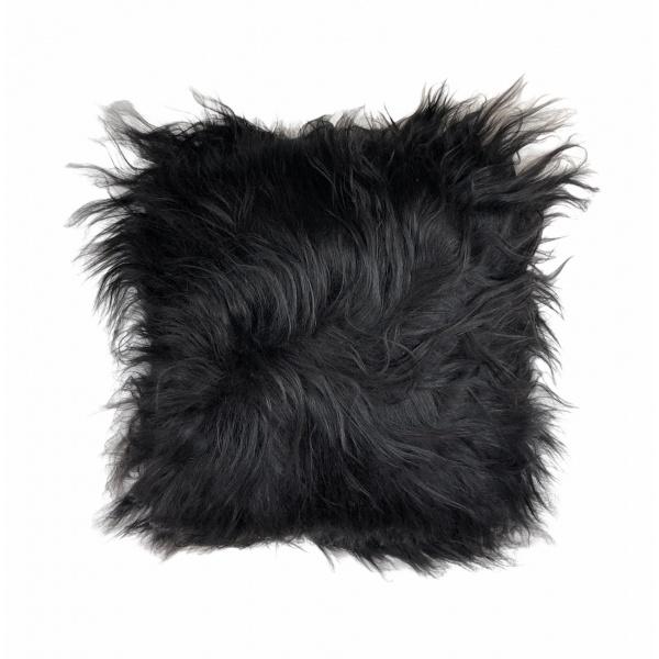 coussin en peau de mouton noir